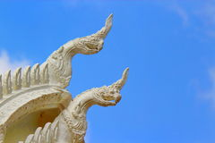 Thai White Gable with Blue Sky Background. Thai Temple White Gable with Blue Sky Background Stock Photo
