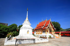 Thai white pagoda and temple against blue sky Stock Photos
