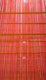 Thai wicker woven  wall  made from plastic  rope Stock Photo
