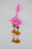Thai wither garland hanging on white wall Royalty Free Stock Image