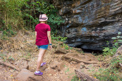 Thai woman adventurer is walking to the Pu Wai cave Stock Image