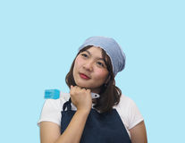 Thai woman chef is cooking Thai foods. Cute chef cutout with blue sky stock photography