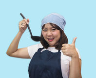 Thai woman chef is cooking Thai foods. Cute chef cutout with blue sky royalty free stock photos