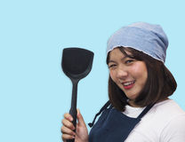Thai woman chef is cooking Thai foods. Cute chef cutout with blue sky royalty free stock image