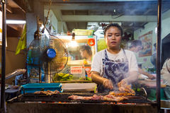 Thai woman cooking Chicken brochettes Royalty Free Stock Photography
