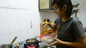 Thai woman cooking Octopus and Squid boiled stock video footage