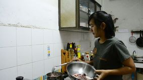 Thai woman cooking Octopus and Squid boiled stock video