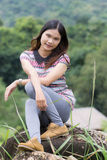 Thai Woman Enjoy on The rock in Field Doi inthanon Royalty Free Stock Photography