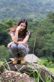 Thai Woman Enjoy on The rock in Field Doi inthanon Royalty Free Stock Photo