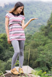 Thai Woman Enjoy on The rock in Field Doi inthanon Royalty Free Stock Photos