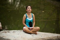 Thai woman exercise on ground in the park . Stock Image