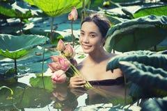 Thai woman Farmer  collecting lotus in garden, thai lifestyle Stock Photo