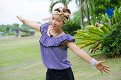 A Thai woman feel free on weekend at park Royalty Free Stock Photo