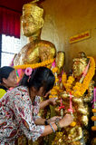 Thai Woman glid cover angel statue with gold leaf at Phra Kal Sh Stock Image