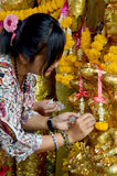 Thai Woman glid cover angel statue with gold leaf at Phra Kal Sh Royalty Free Stock Photography