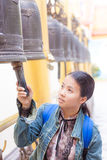 Thai woman hit the bell Stock Image