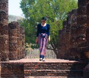 Free Thai Woman In Blue Thai Dress With Old Temple At Sukhothai Historical Park, One Of Thailand&x27;s World Heritage Site. Royalty Free Stock Photos - 173348588
