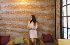 Thai Woman lonely standing in office royalty free stock images