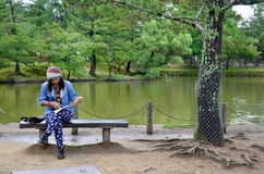 Thai woman looking map at the garden of Todai-ji Temple Stock Photo