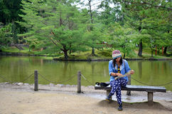 Thai woman looking map at the garden of Todai-ji Temple Stock Image