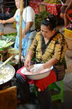 Thai woman making food on the streets Royalty Free Stock Image