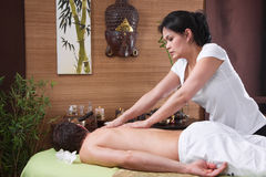 Thai woman making massage to a man Royalty Free Stock Photography
