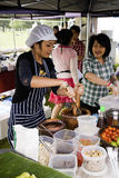 Thai Woman Making Papaya salad (Som Tam). Women at a Thai cultural fayre making papaya Salad (Som Tam) for sale to the public Royalty Free Stock Photography