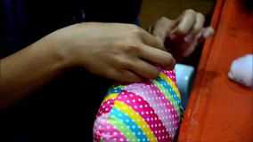 Thai woman Needlework or sewing cotton owl doll pillow stock video footage