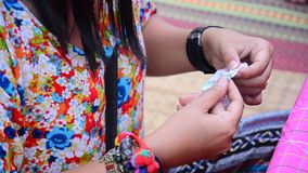 Thai woman Needlework or sewing cotton and textiles stock video