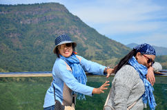 Thai woman and old women playing and portrait with view of Khao Stock Photography