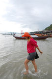 Thai woman playing on the beach at Fishing Village Koh Phithak Island Stock Image