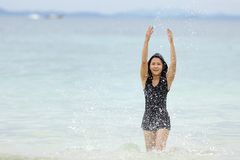 Thai woman playing in sea Royalty Free Stock Photo