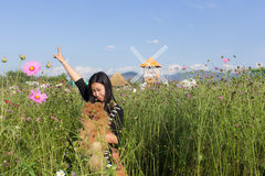 Thai woman and pomeranian with turbine in cosmos field, Muangkae Royalty Free Stock Photos
