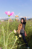Thai woman and pomeranian with turbine in cosmos field, Muangkae Stock Photo