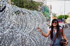 Thai woman portrait with Barbed wire for Defence Stock Photo