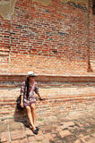 Thai woman portrait at Brick wall Background of Temple in Ayutthaya Thailand. Royalty Free Stock Photos
