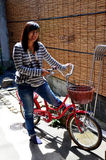 Thai woman portrait with classic red bicycle Stock Photography