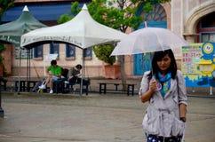 Thai woman portrait holding umbrella while raining at Wakayama M Royalty Free Stock Photography