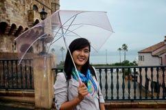 Thai woman portrait holding umbrella while raining at Wakayama M Royalty Free Stock Images
