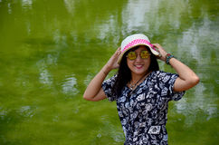 Thai woman portrait at beside natural green swamp or nature gree Stock Photo