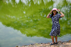 Thai woman portrait at beside natural green swamp or nature gree Stock Photos