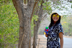 Thai woman portrait and play water gun toy at outdoor Stock Photo