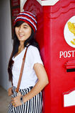Thai woman portrait with post box Stock Images
