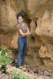 Thai Woman portrait standing near Cliff Stock Photography