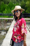 Thai woman portrait with tripod on the bridge in Mangrove forest Stock Photo