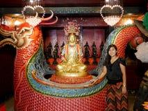 Thai woman posing with Chinese shrine of Lady princess Soi Dok M Royalty Free Stock Image