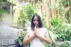 Thai woman praying in a buddhist  temple Royalty Free Stock Photography