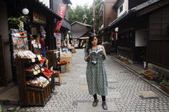 Thai woman reading guide book and visit snack and candy alley ja Royalty Free Stock Image