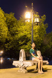 Thai Woman Relax in Park at night near river Stock Photos