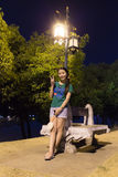 Thai Woman Relax in Park at night near river Royalty Free Stock Image